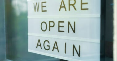 OPEN AGAIN SIGN IN A SMALL BUSINESS WINDOW