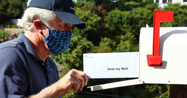 man voting by mail