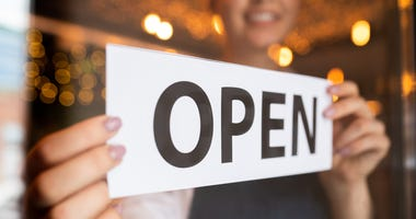 open sign in a small business window