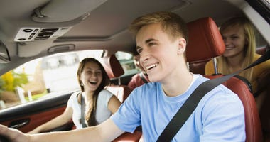 teen driver with friends in the car