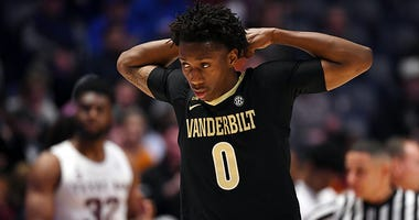 Mar 13, 2019; Nashville, TN, USA; Vanderbilt Commodores guard Saben Lee (0) reacts after a foul call during the first half against the Texas A&M Aggies of the SEC conference tournament at Bridgestone Arena.