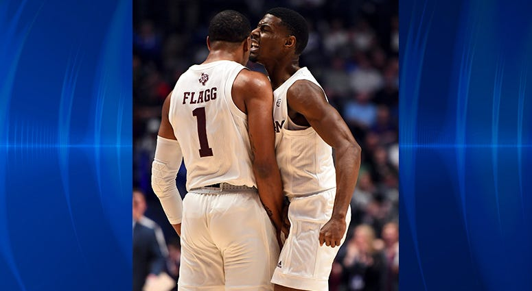 Texas A&M Aggies guard Savion Flagg (1) and Texas A&M Aggies guard Jay Jay Chandler (0) celebrate after a basket against the Vanderbilt Commodores during the first half of the SEC conference tournament at Bridgestone Arena