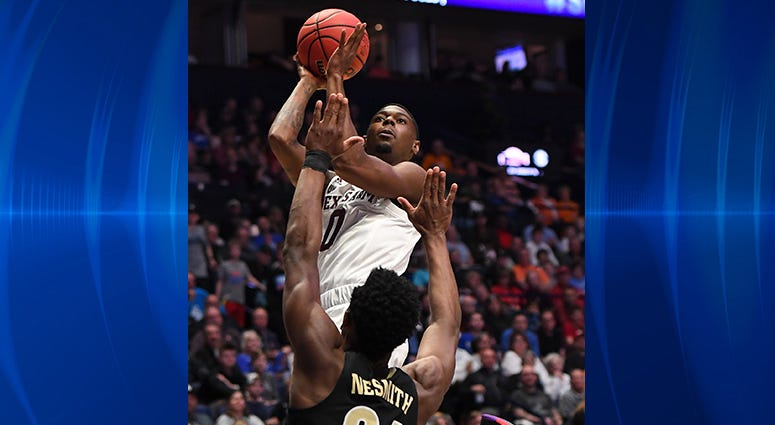 Texas A&M Aggies guard Jay Jay Chandler (0) shoots the ball over Vanderbilt Commodores forward Aaron Nesmith (24) during the first half of the SEC conference tournament at Bridgestone Arena.
