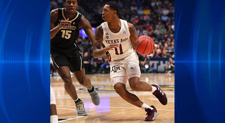 Texas A&M Aggies guard Wendell Mitchell (11) dribbles the ball around Vanderbilt Commodores forward Clevon Brown (15) during the first half of the SEC conference tournament at Bridgestone Arena.