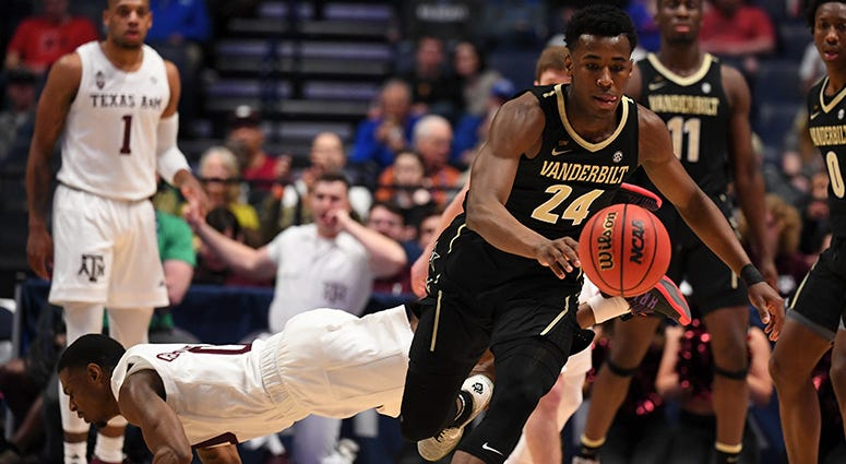 Vanderbilt Commodores forward Aaron Nesmith (24) chases down a loose ball after an attempted steal by Texas A&M Aggies guard Jay Jay Chandler (0) during the first half of the SEC conference tournament at Bridgestone Arena.