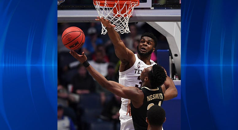 Texas A&M Aggies forward Josh Nebo (32) attempts to block a shot attempt by Vanderbilt Commodores forward Aaron Nesmith (24) during the first half of the SEC conference tournament at Bridgestone Arena.