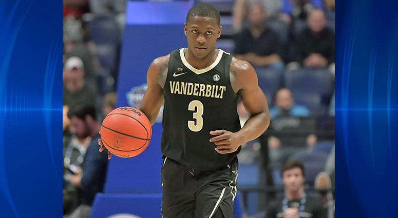Vanderbilt Commodores guard Maxwell Evans (3) dribbles the ball against the Texas A&M Aggies in the first half in the SEC conference tournament at Bridgestone Arena.