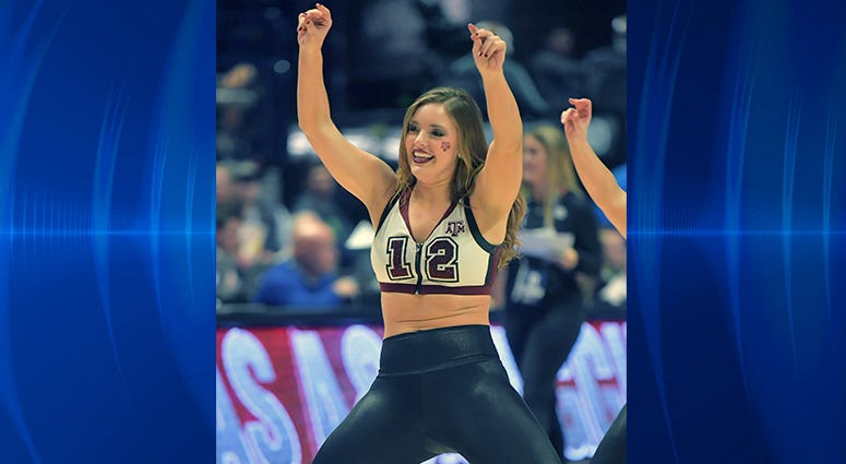 Texas A&M Aggies cheerleader performs against the Vanderbilt Commodores in the SEC conference tournament at Bridgestone Arena.