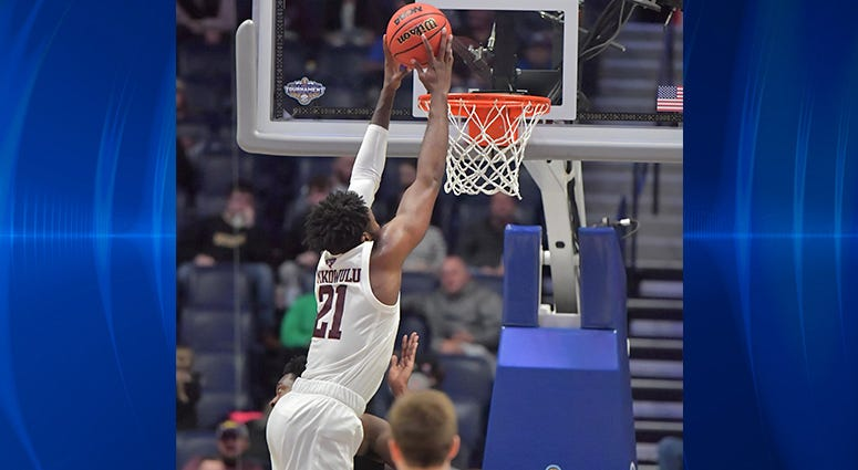 Texas A&M Aggies forward Christian Mekowulu (21) dunks the ball in the first half against the Vanderbilt Commodores in the SEC conference tournament at Bridgestone Arena.
