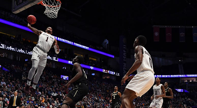 Texas A&M Aggies guard Savion Flagg (1) dunks the ball during the first half against the Vanderbilt Commodores of the SEC conference tournament at Bridgestone Arena.