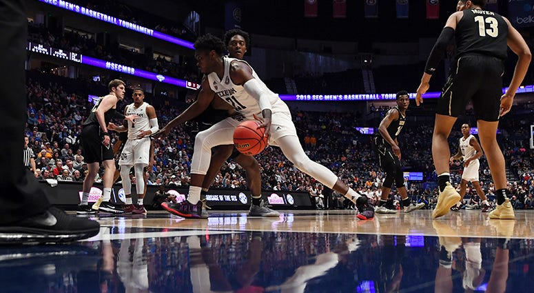 Texas A&M Aggies forward Christian Mekowulu (21) drives to the basket against the Vanderbilt Commodores during the first half of the SEC conference tournament at Bridgestone Arena.