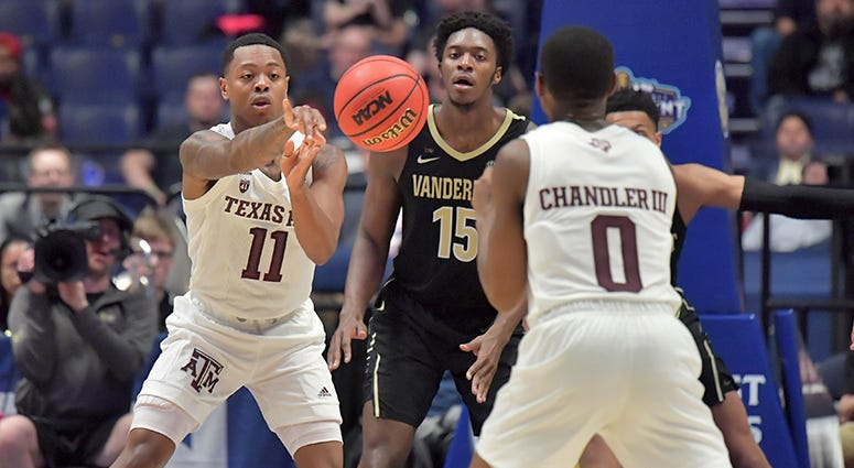 exas A&M Aggies guard Wendell Mitchell (11) passes the ball against the Vanderbilt Commodores in the SEC conference tournament at Bridgestone Arena.