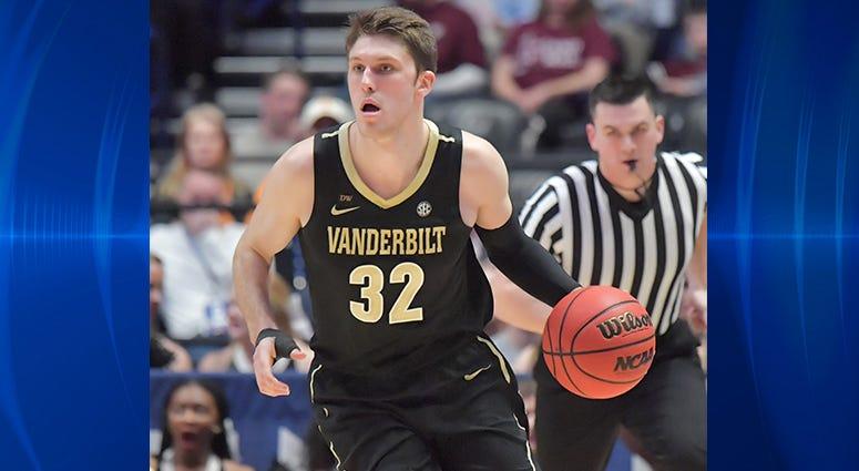 Vanderbilt Commodores forward Matt Ryan (32) dribbles the ball against the Texas A&M Aggies in the SEC conference tournament at Bridgestone Arena.