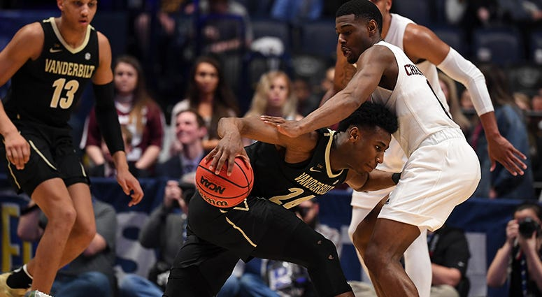 Vanderbilt Commodores forward Aaron Nesmith (24) is guarded by Texas A&M Aggies guard Jay Jay Chandler (0) during the first half of the SEC conference tournament at Bridgestone Arena.