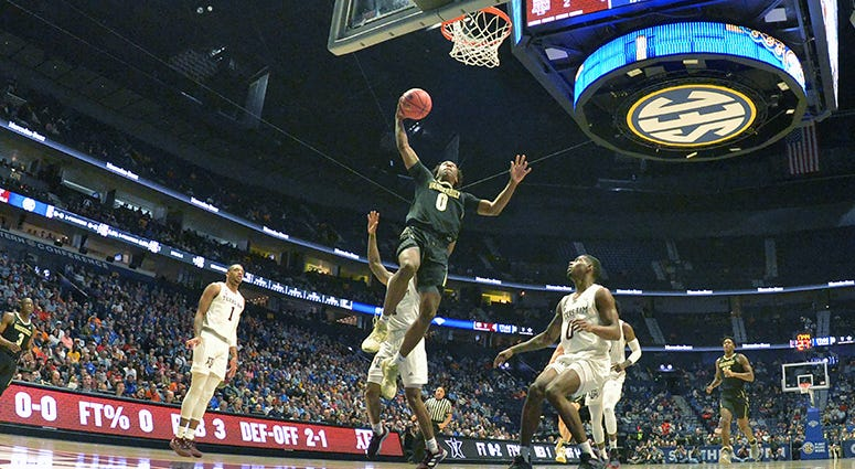 Vanderbilt Commodores guard Saben Lee (0) shoots the ball against the Texas A&M Aggies during the first half of game two in the SEC conference tournament at Bridgestone Arena.