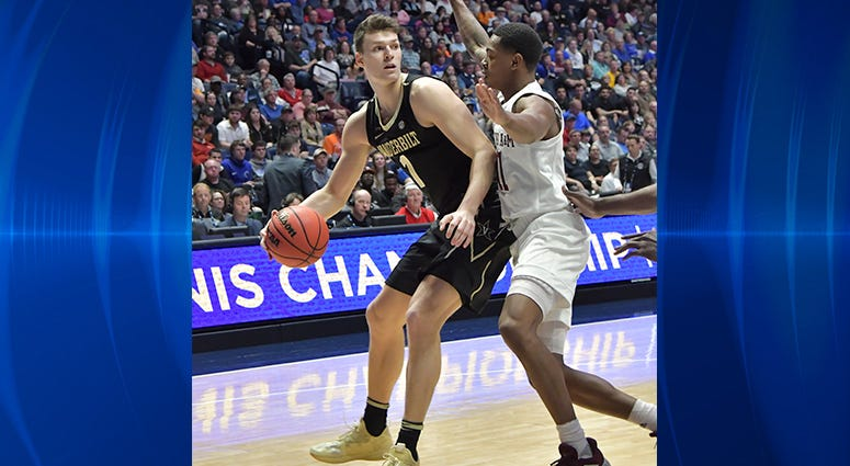 Vanderbilt Commodores forward Yanni Wetzell (1) is defended by Texas A&M Aggies guard Wendell Mitchell (11) during the first half of game two in the SEC conference tournament at Bridgestone Arena.
