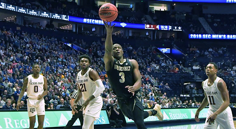 Vanderbilt Commodores guard Maxwell Evans (3) shoots the ball against the Texas A&M Aggies during the first half of game two in the SEC conference tournament at Bridgestone Arena.