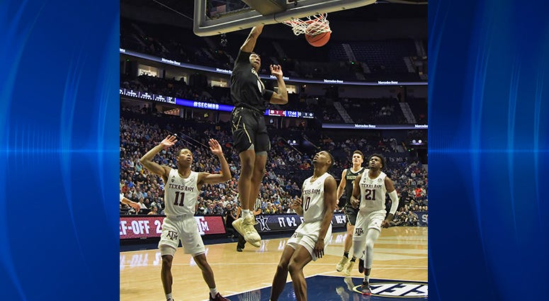 Vanderbilt Commodores guard Saben Lee (0) dunks the ball against the Texas A&M Aggies during the first half of game two in the SEC conference tournament at Bridgestone Arena.