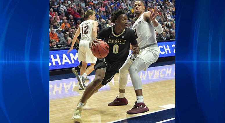 Vanderbilt Commodores guard Saben Lee (0) dribbles the ball against the Texas A&M Aggies during the first half of game two in the SEC conference tournament at Bridgestone Arena.