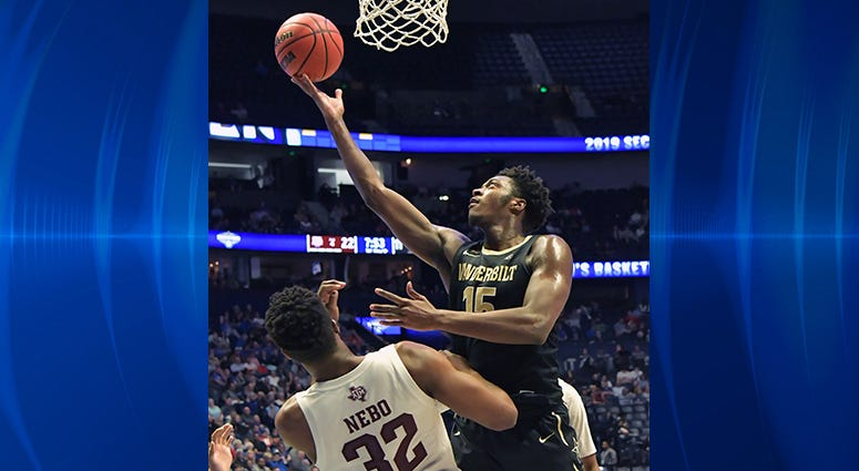 Vanderbilt Commodores forward Clevon Brown (15) is defended by Texas A&M Aggies forward Josh Nebo (32) during the first half of game two in the SEC conference tournament at Bridgestone Arena.