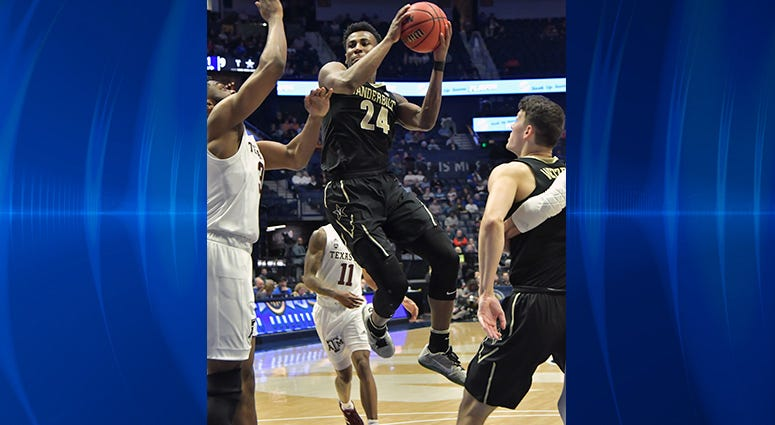 Vanderbilt Commodores forward Aaron Nesmith (24) shoots the ball against the Texas A&M Aggies during the first half of game two in the SEC conference tournament at Bridgestone Arena.