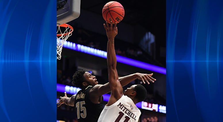 Texas A&M Aggies guard Wendell Mitchell (11) is fouled by Vanderbilt Commodores forward Clevon Brown (15) while shooting the ball during the first half of the SEC conference tournament at Bridgestone Arena.
