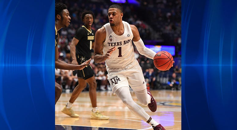 Texas A&M Aggies guard Savion Flagg (1) dribbles the ball against the Vanderbilt Commodores during the first half of the SEC conference tournament at Bridgestone Arena.
