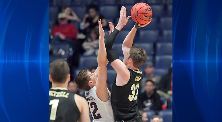 Vanderbilt Commodores forward Matt Ryan (32) is defended by Texas A&M Aggies guard Chris Collins (12) in the second half of the SEC conference tournament at Bridgestone Arena.