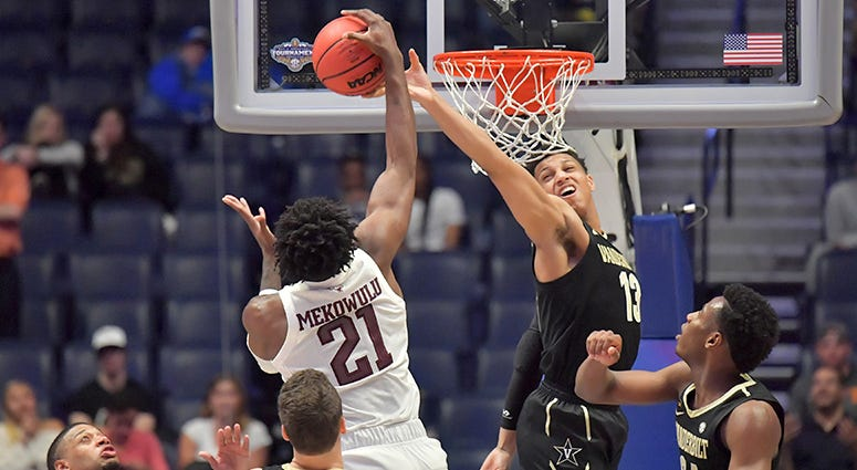 exas A&M Aggies forward Christian Mekowulu (21) and Vanderbilt Commodores forward Matthew Moyer (13) battle for the ball in the second half of the SEC conference tournament at Bridgestone Arena.