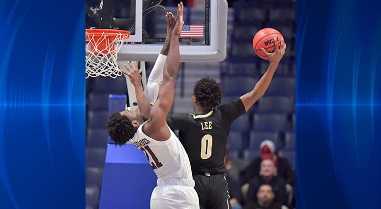 Vanderbilt Commodores guard Saben Lee (0) is defended by Texas A&M Aggies forward Christian Mekowulu (21) in the second half of the SEC conference tournament at Bridgestone Arena.