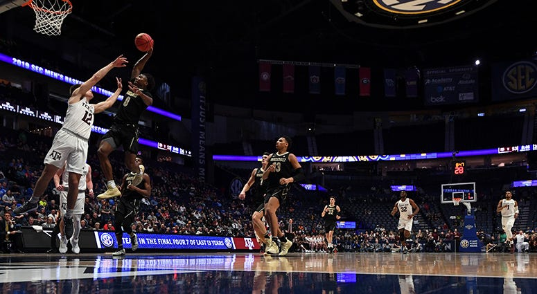 Vanderbilt Commodores guard Saben Lee (0) dunks the ball over Texas A&M Aggies guard Chris Collins (12) during the second half of the SEC conference tournament at Bridgestone Arena.