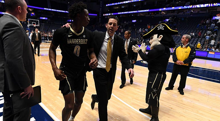 anderbilt Commodores head coach Bryce Drew and Vanderbilt Commodores guard Saben Lee (0) walk off the court after a loss to the Texas A&M Aggies of the SEC conference tournament at Bridgestone Arena.