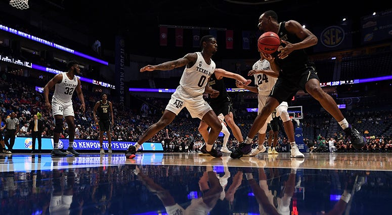 Vanderbilt Commodores guard Joe Toye (2) works against Texas A&M Aggies guard Jay Jay Chandler (0) during the second half of the SEC conference tournament at Bridgestone Arena.