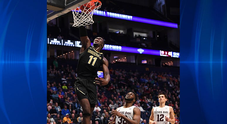 Vanderbilt Commodores forward Simisola Shittu (11) dunks the ball during the second half against the Texas A&M Aggies of the SEC conference tournament at Bridgestone Arena.