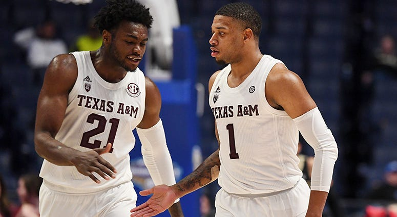 Texas A&M Aggies forward Christian Mekowulu (21) and Texas A&M Aggies guard Savion Flagg (1) celebrate in the final minutes of a win against the Vanderbilt Commodores in the SEC conference tournament at Bridgestone Arena.
