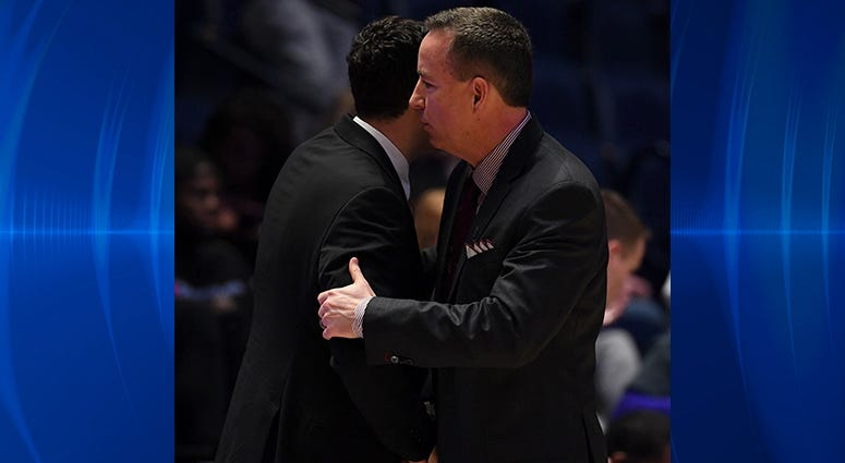 Vanderbilt Commodores head coach Bryce Drew and Texas A&M Aggies head coach Billy Kennedy/ after an Aggies win in the SEC conference tournament at Bridgestone Arena.