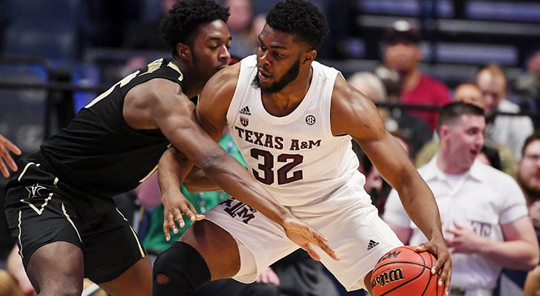 Texas A&M Aggies forward Josh Nebo (32) works against Vanderbilt Commodores forward Clevon Brown (15) during the second half of the SEC conference tournament at Bridgestone Arena.