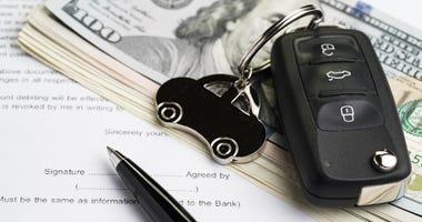 car keys on paperwork