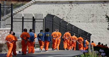 Court orders California to cut San Quentin inmates by half