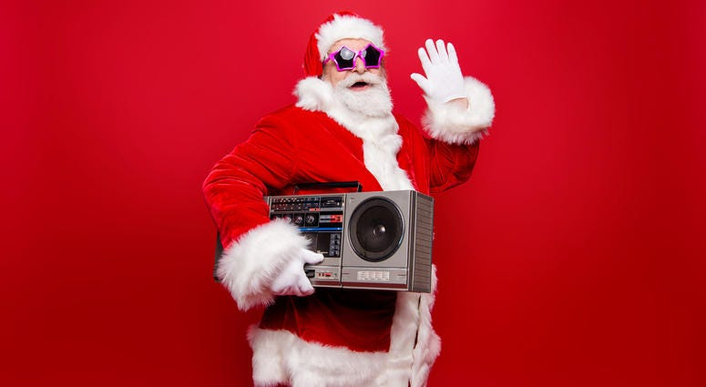 santa clause wearing shades with a boombox