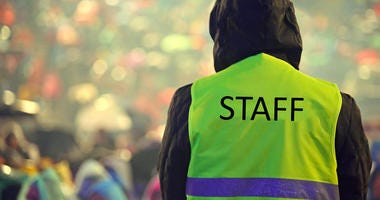 man wearing an event staff high visibility vest