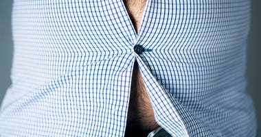 beer belly stretching buttons on a shirt