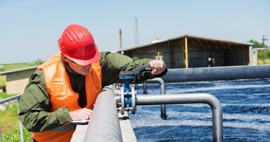 worker and water treatment tank
