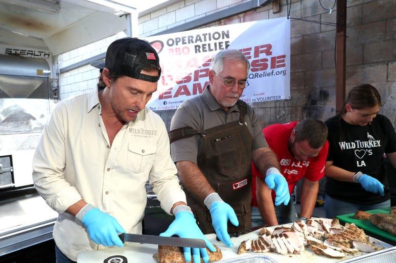 Matthew McConaughey cutting up meat