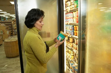 Woman looking at a tub of ice cream