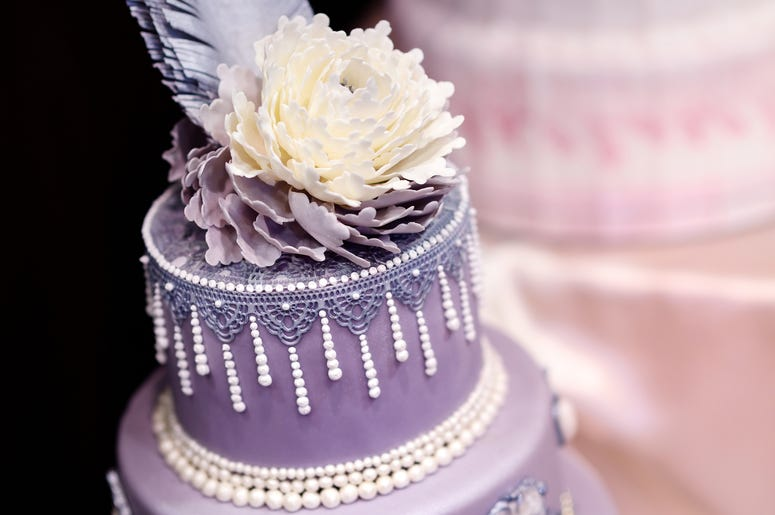 Purple Cake With White Flowers
