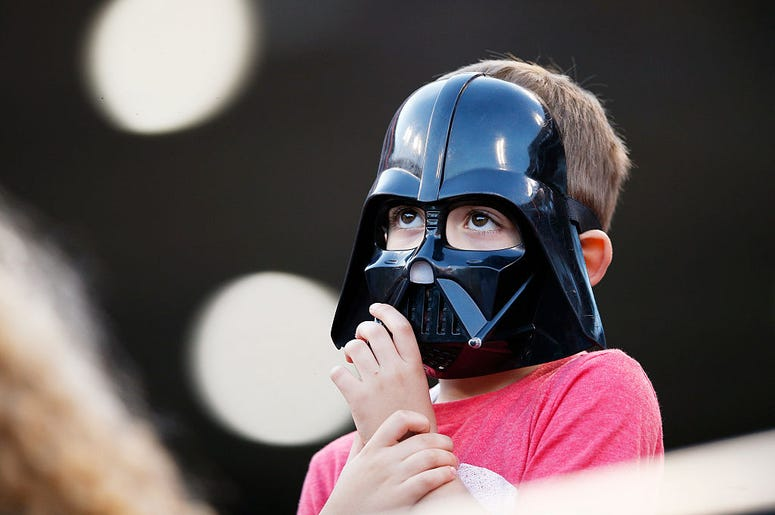 Kid in a Darth Vader mask