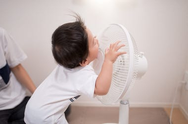 baby and a fan