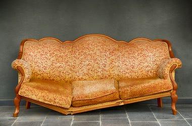 Broken Armchair, Orange, Wall