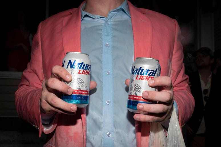 Guy Holding Natural Light Beer